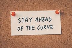 Stay ahead of the curve. Note pinned on the bulletin board Stock Photos
