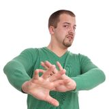 Stay away. Young man gesturing with raised hands Royalty Free Stock Photos