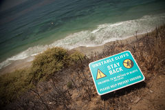 Stay Back Warning Sign at Cliff Edge Royalty Free Stock Images