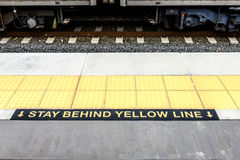 Stay Behind Yellow Line Royalty Free Stock Photo