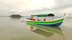 Stay. The boat and the shadow in the middle of the sea in Thailand Royalty Free Stock Images