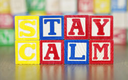Stay Calm Spelled Out in Alphabet Building Blocks Stock Photos