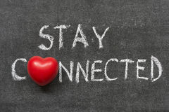 Stay connected. Phrase handwritten on blackboard with heart symbol instead of O royalty free stock photos