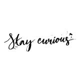 Stay curious. Calligraphy with ink drops. Inspirational quote expressive handwritten with brush, isolated on white background. Vector design for t-shirts Royalty Free Stock Image