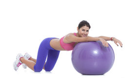 Stay fit with a swiss ball! Royalty Free Stock Images