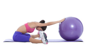 Stay fit with a swiss ball!. Active fit woman having a break on a swiss ball Stock Photography