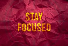 Stay focus in gold texture on crumpled red paper background,busi Royalty Free Stock Photo