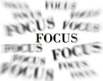 Stay in Focus. The word focus with zoomed words in background on white as concept for business ideas royalty free illustration