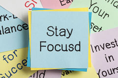 Stay Focusd. Top view of Stay Focusd handwritten on a note stock photography