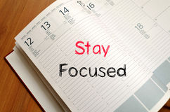 Stay focused concept on notebook Royalty Free Stock Photos