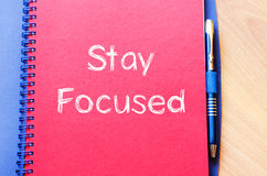Stay focused concept on notebook Stock Photography