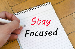 Stay focused concept on notebook Royalty Free Stock Photo