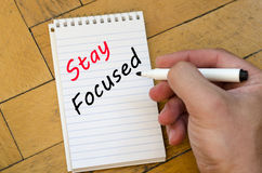 Stay focused concept on notebook Stock Images