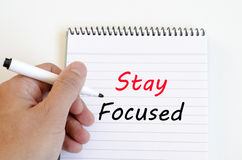 Stay focused concept on notebook Stock Image