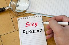 Stay focused concept on notebook Royalty Free Stock Photography