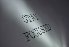 Stay focused. Light centred on the words stay focused motivational phrase royalty free stock image