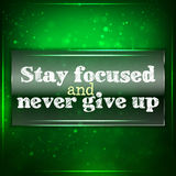 Stay focused and never give up. Futuristic motivational background. Chalk text written on a piece of glass Stock Photo