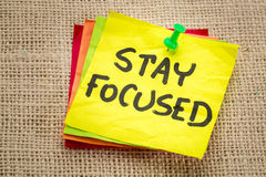Stay focused reminder on a sticky note. Motivation concept Stock Images