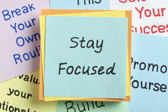 Stay Focused. Top view of Stay Focused handwritten on a note stock photo