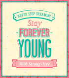 Stay forever young inscription on beautiful backgr Stock Images