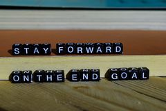 Stay forward on the end goal on wooden blocks. Motivation and inspiration concept. Cross processed image royalty free stock images