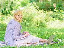 Stay free with remote job. Managing business remote outdoors. Woman with laptop sit grass meadow. Best jobs to work. Remotely. Business lady freelance work royalty free stock photos