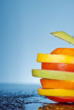 Stay healthy. Fruit and vegetable slices on a blue background Royalty Free Stock Image