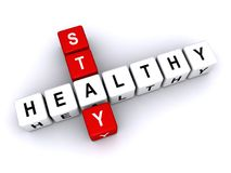 Stay healthy. Text 'stay healthy' inscribed in uppercase letters on small cubes and arranged crossword style with common letter 'a', white background Stock Photo