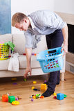 Stay-at-home dad. Cleaning up drawing room royalty free stock photo