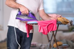 Stay-at-home dad ironing stock photos
