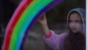 Free Stay Home, Flash Mob Chase The Rainbow. Girl In Pajamas Draws The Rainbow On The Window At Home Stock Image - 185920571