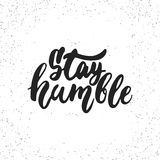Stay humble - hand drawn lettering phrase isolated on the white grunge background. Fun brush ink inscription for photo Stock Image