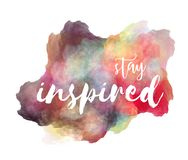 Stay inspired hand lettering phrase on watercolor imitation color splash with drop shadow over white background. Inspirational quote for t-shirts design etc stock illustration