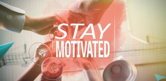 Composite image of stay motivated. Stay motivated against businesspeople toasting a glasses of wine royalty free stock image