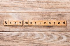 Stay motivated word written on wood block. Stay motivated text on wooden table for your desing, concept royalty free stock photo