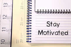 Stay motivated write on notebook Royalty Free Stock Photo