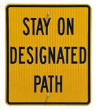 Stay On Path. Stay On Designated Path isolated metal sign stock photography