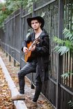 Stay and play. Music in the park autumn day royalty free stock photo