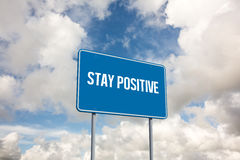 Stay positive against blue sky with white clouds Royalty Free Stock Photos