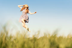 Stay positive. Girl, jumping in the field Royalty Free Stock Images