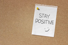 Stay Positive. Motivational Concept Image of message note paper pinned on cork board with Stay Positive words written on it stock photos