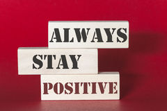 Always stay positive quote. Always stay positive. Motivational quote written on wooden tiles Stock Photography