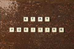 Stay positive. Text on a rustic background stock images