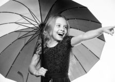 Stay positive though autumn rain season. Bright accessory for autumn. Ideas how survive cloudy autumn day. Small girl stock image