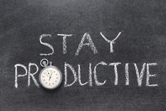 Stay productive. Phrase handwritten on chalkboard with vintage precise stopwatch used instead of O royalty free stock image