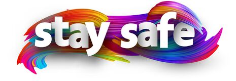 Stay Safe Sign Over Brush Strokes Background Stock Photo