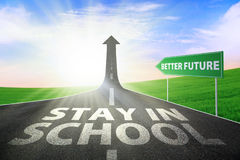 Stay in school for better future. A road turning into an arrow rising upward with a text of STAY IN SCHOOL, symbolizing the path to gain better future stock images