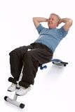 Stay in shape. Mature adult exercising his abdomen to stay in shape Royalty Free Stock Images