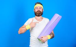 Stay in shape. Athlete professional yoga coach motivated for training. Lets start yoga class. Yoga as hobby and sport. Practicing yoga every day. Man bearded royalty free stock photography