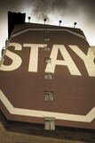 Stay sign painted on building Royalty Free Stock Photography